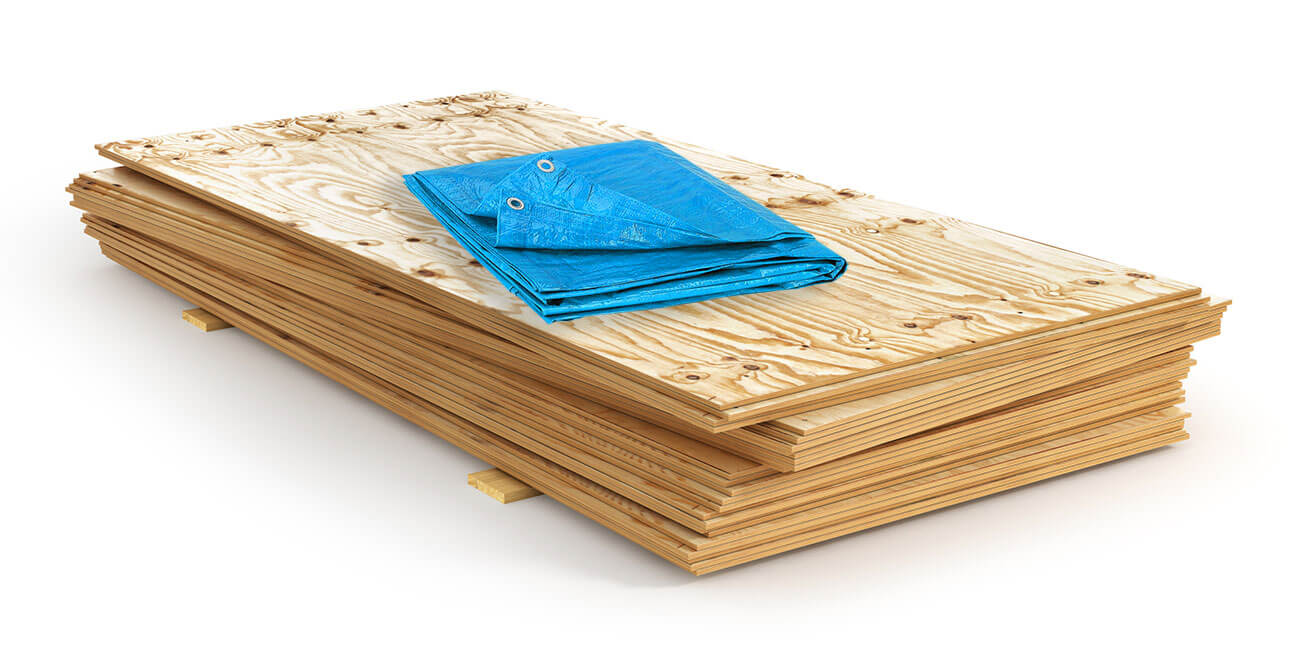 We'll Protect Your Property using Plywood and Tarps